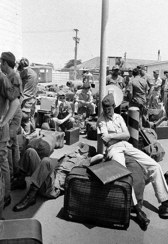 In this March 27, 1973 photo, an American GI takes a nap atop his luggage as he and other troops wait to begin out processing at Camp Alpha in Saigon, as withdrawal of U.S. troops resume after a 10-day dispute over POWs.