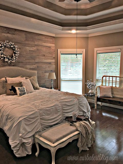 Rustic Bedroom with Distressed Ottoman