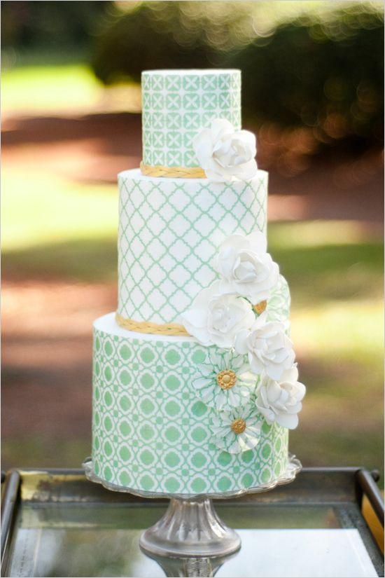 Green patterned three-tier wedding cake