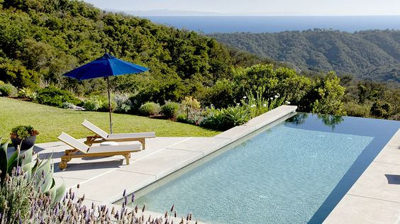 Real Estate Envy: 7 Dreamy Vacation Homes // pool, lounge chaises, outdoor umbrella, mountians