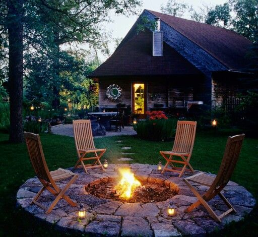 Pull up a chair around this in-ground fire pit.