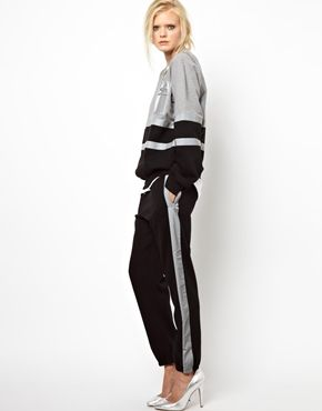 Pinning this for the fab track suit high heel combo. Whenever I go running I wear a 200 dollar ensemble and hooker heels. I also never go running.