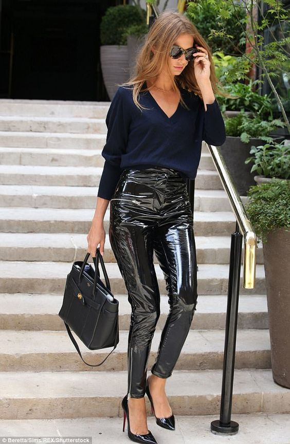 Nice to PVC you: The former Made In Chelsea star, 28, commanded attention in striking PVC trousers as she headed out in the city - flashing the dazzling diamond for all to see