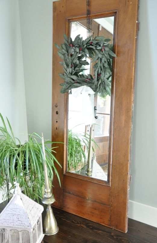 Old door made into a full lenghth mirror!! So doing this in the dining room!!