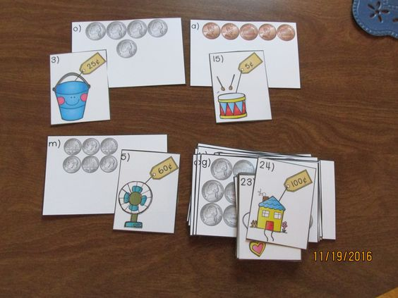 "Counting Coins includes pennies, nickels, and dimes. Students count only these coins. They are not mixed together. This product is perfect for a beginning money unit. Students can play ""Match"" or ""Go Fish"". The coin cards themselves can be used as task cards to play ""Scoot"", cooperative activities like ""Quiz, Quiz Trade"" or ""Numbered Heads Together"", placed at a math center, etc. You can also give students your own plastic coins and the cards with the price tags on them and they count the…"