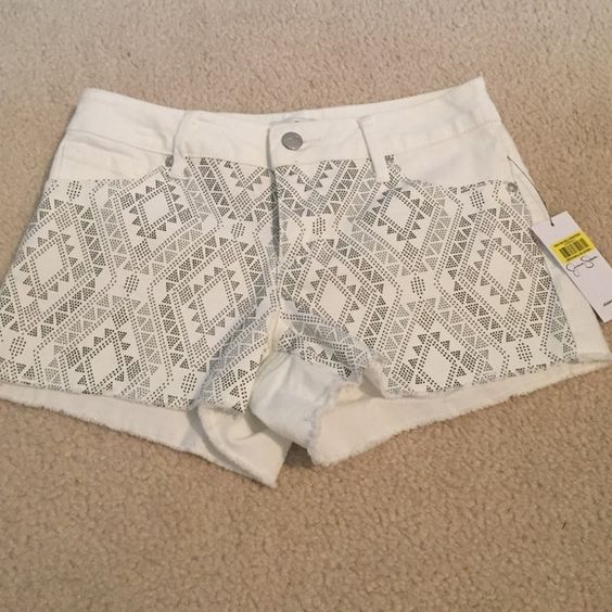 NWT. Jessica Simpson jean shorts NWT Jessica Simpson white denim shorts  , front black design , plain back , 7 inch rise 11 inches too to bottom sizes available 25,28   $22 each Jessica Simpson Shorts Jean Shorts