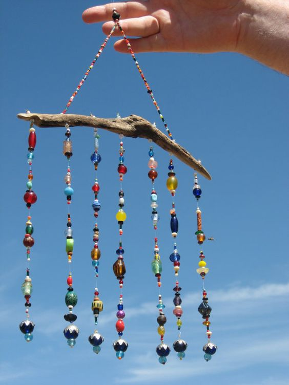Used as a wall hanging, suncatcher, or as a mobile, this lovely beaded hanging decoration brings a playful beauty to any space.  This mobile measures