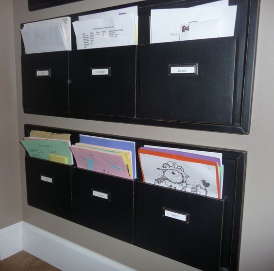 attractive wall files solution (i like these a lot... wondering if i can DIY something like this up??)
