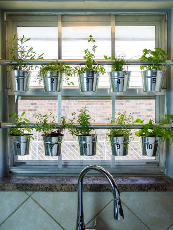 What could be greener — color wise, and also environmentally speaking — than growing herbs right in your own kitchen? Growing herbs indoors isn't without its challenges, but if your kitchen has sufficient light, you can save money on grocery bills, make your kitchen smell amazing, and reduce the distance from farm to table to, oh, about fifteen feet. Here are a few ideas to get you started.: