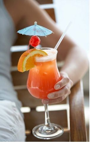 Sunset On the Beach ~ 1 part amaretto, 1 part peach schnapps, topped with pineapple juice and cranberry juice drink..