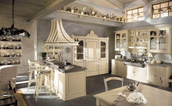 Colori tenui per la cucina - Mobilio bianco e pareti grigie per una stanza country moderna.