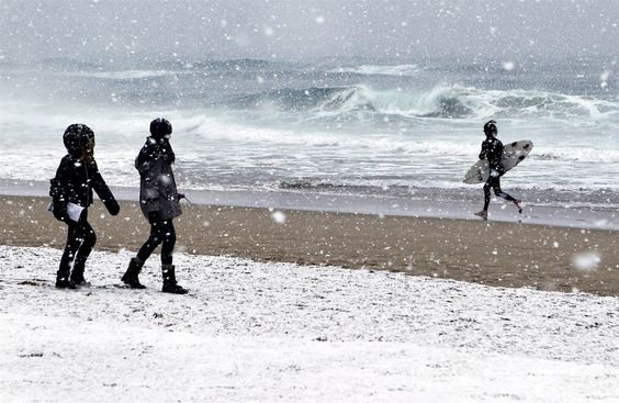 A surfing enthusiast gets ready to brave the icy waters at La Zurriola beach in San Sebastián on Feb. 4. An ongoing cold spell has hit Europe with temperatures plummeting far below zero.