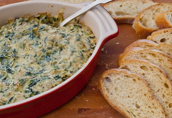 I love spinach and artichoke dip, especially served warm right out of the oven, but a good one is hard to come by. The problem is that most recipes call for canned or marinated artichokes -- which are tinny and sour tasting -- as well as sour cream (yet more tang) and an ungodly amount of mayonnaise (hard to enjoy eating, especially if you're the o