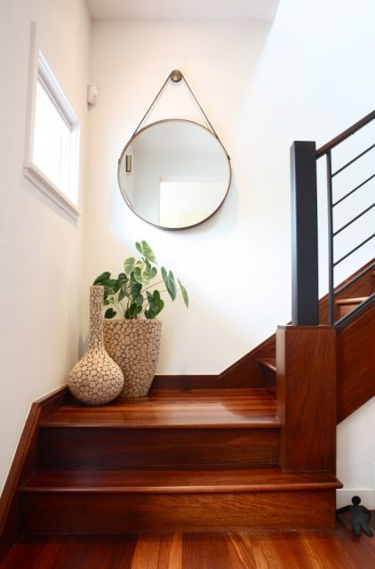 Keep it simple. If the space on your stair landing is minimal, keep things simple. Gather a gorgeous mirror or artwork and a couple of decorative vases.