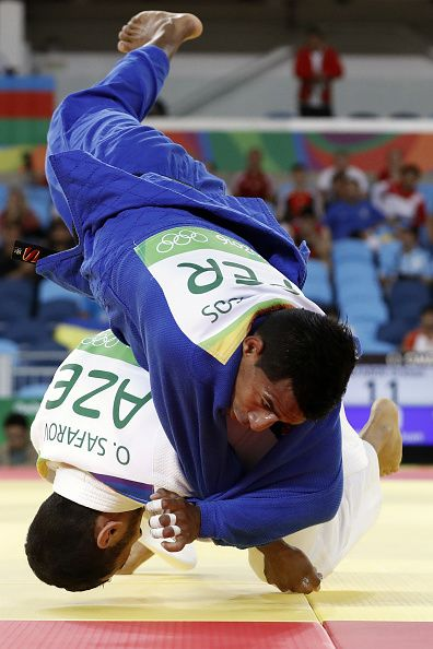 #RIO2016 Best of Day 1 - Azerbaijan's Orkhan Safarov competes with Peru's Juan Postigos during their men's 60kg judo contest match of the Rio 2016 Olympic Games in Rio de...