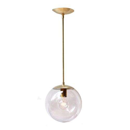 So happy we have finally emerged from the nickel-plated world we have been living in.  Loving brass!!  Alto Pendant: Remodelista