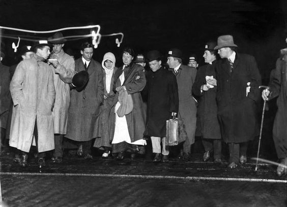 Survivors of the sinking of the RMS Titanic are interviewed by reporters as they come off the RMS Carpathia in New York on April 18, 1912. (The New York Times)