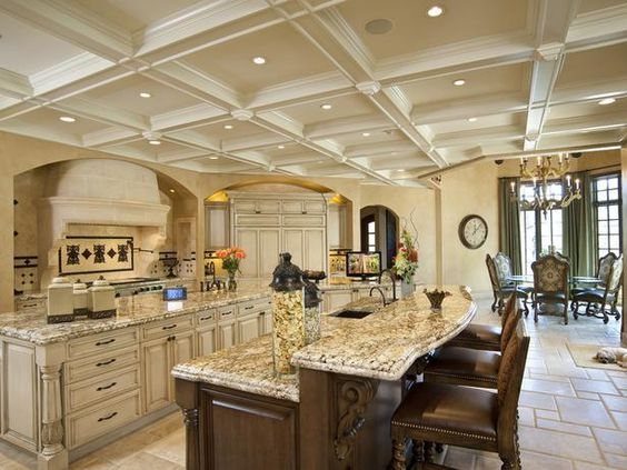 Incredible kitchen. Love the cabinets and ceiling.