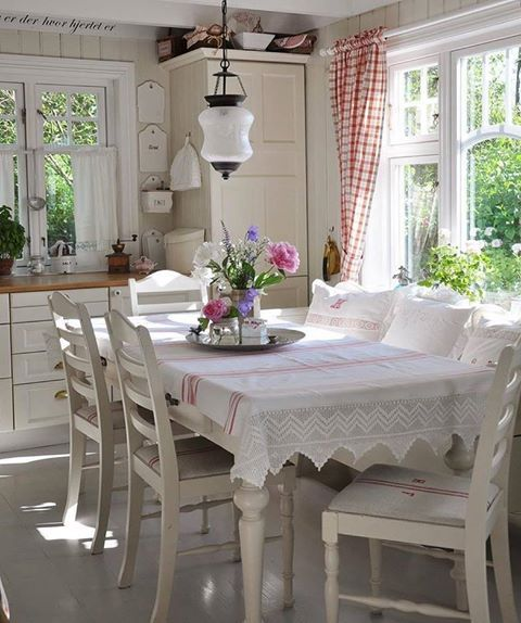 Red and white ticking and accents in a white kitchen with Scandinavian charm. #kitchen #swedish #scandinavian #country #shabbychic #red