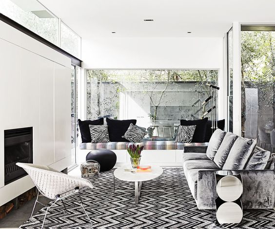 Living Room: Large Glass Windows, Fireplace, Concealed