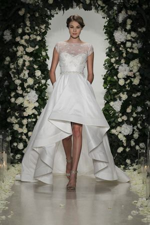 Embellished, high-neck illusion neckline wedding dress with cap sleeves, high-low hemline and pockets by @annebargebride | Bridal Market Fall 2016