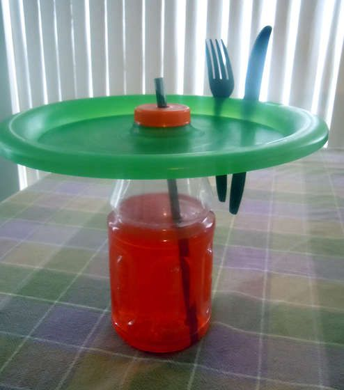 """GENIUS! """"Volcano Plate"""" with spots for your utensils and a hole in the middle for your drink. No more worrying about having enough hands or flat spots for everything!"""
