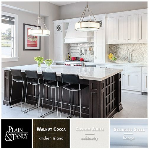 This transitional kitchen color palette has a rich dark walnut island and custom white kitchen cabinets.