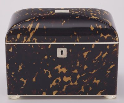 A fine tortoiseshell teacaddy by Lund of Fleet Street, edged with ivory and with bun feet in the same, a pair of lids of matching tortoiseshell cover the two compartments within.  William Lund moved to premises in Fleet Street in 1840, and changed his label in 1876 when he was joined by his son.