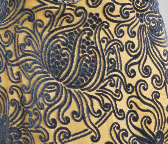 Metallic lace evening dress fabric detail.