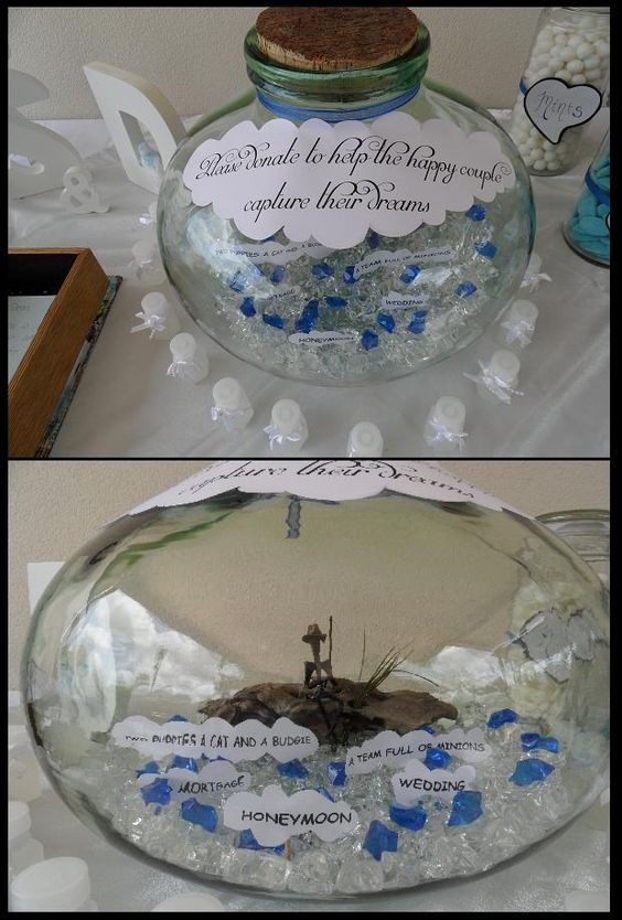 Instead of a wishing well to collect donations we used a glass bowl with a fisherman inside who was trying to 'catch our dreams'. We rested him on a log with clear and blue glass rocks as water. In the water we had our dreams on clouds so our guests knew exactly what the money would go towards...with a few silly extras from my fiancé!