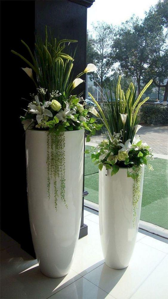 Tall plant pots with lilies #gardenIdeas #garden #gardening #plants #homeDecor #indoor