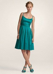 Timeless and chic, this short cotton sateen dress will never go out of style!  Spaghetti strap bodice is accented with a pleated waist band to create curves.  Fun and flirty full skirt features pockets giving this already versatile style even more wear-again appeal.  Cotton sateen fabric is comfortable and light, great for a long night of dancing.  Fully lined. Imported polyester. Dry clean only.  Check local stores for availability.