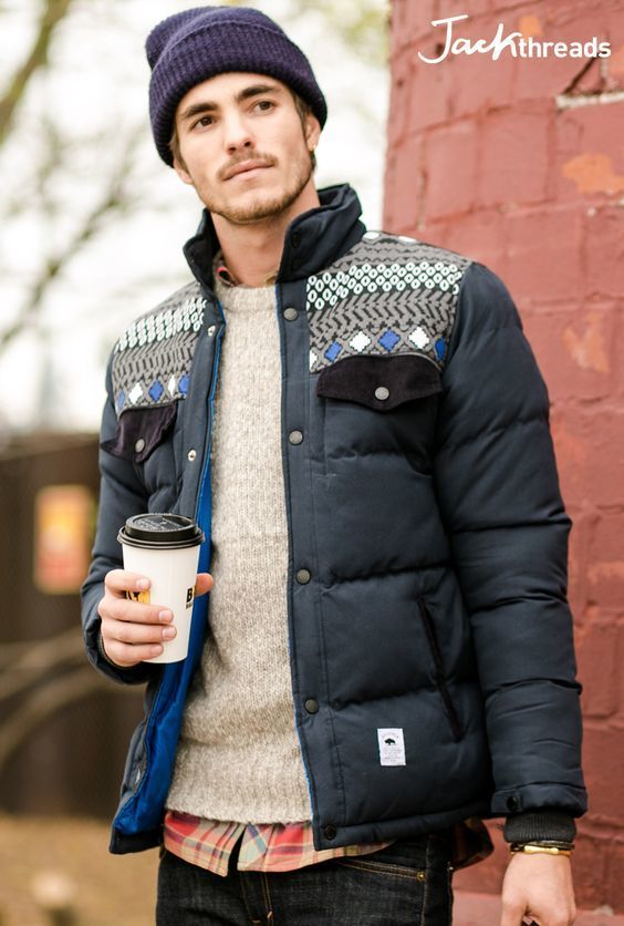 Something as simple as teaming a black puffer jacket with black jeans can potentially set you apart from the crowd.   Shop this look on Lookastic: https://lookastic.com/men/looks/puffer-jacket-crew-neck-sweater-long-sleeve-shirt/17101   — Dark Purple Beanie  — Red Plaid Long Sleeve Shirt  — Beige Crew-neck Sweater  — Black Puffer Jacket  — Black Jeans