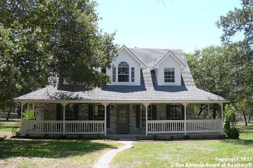Ranch style ranch style house and wrap around porches on for Ranch with wrap around porch