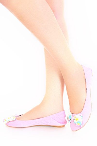 Grosgrain fabric upper in a slip-on casual ballet flat style with a round toe. Floral bows embellishment adds touch of femininity. Smooth lining and cushioning insole. Flexible midsole. Rubber traction outsole.