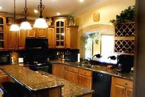 Kitchen Makeovers with Oak Cabinets - Bing images inspiration for counter tops etc with oak cabinets