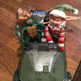 Buddy the elf duck taped Barbie to the back of his ride!