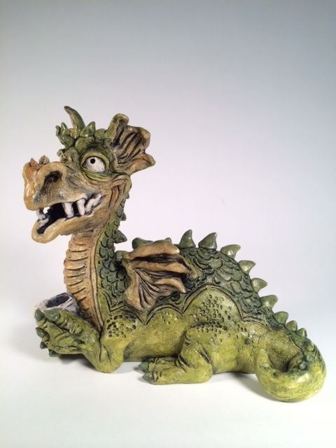 Get a one of a kind Dragon Sculpture... This is Sir. Ren Crooktail the Dragon. He can be found on Etsy......Samclarkart's page.