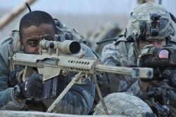 A sniper team using a Berrett .50 in Afghanistan.