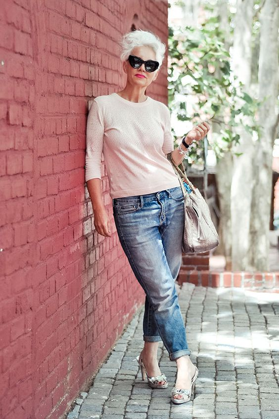 Over 50 can wear boyfriend jeans. Just add jewelery: