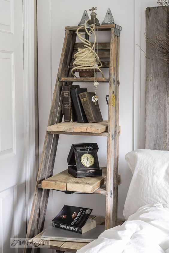 Make a stepladder side table with a full ladder and reclaimed planks via FunkyJunkInteriors.net: