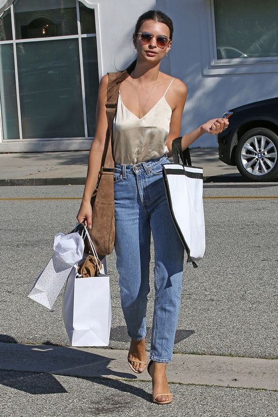 Emily Ratajkowski is an indisputable Goddess in a silk cami top and vintage Levi high waisted jeans