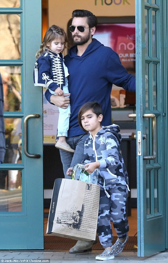 Daddy duty: Scott Disick treated son Mason and daughter Penelope to treats from Barnes and Noble, amid reports ex Kourtney is not impressed with his plans to host a Vegas New Year's Eve bash