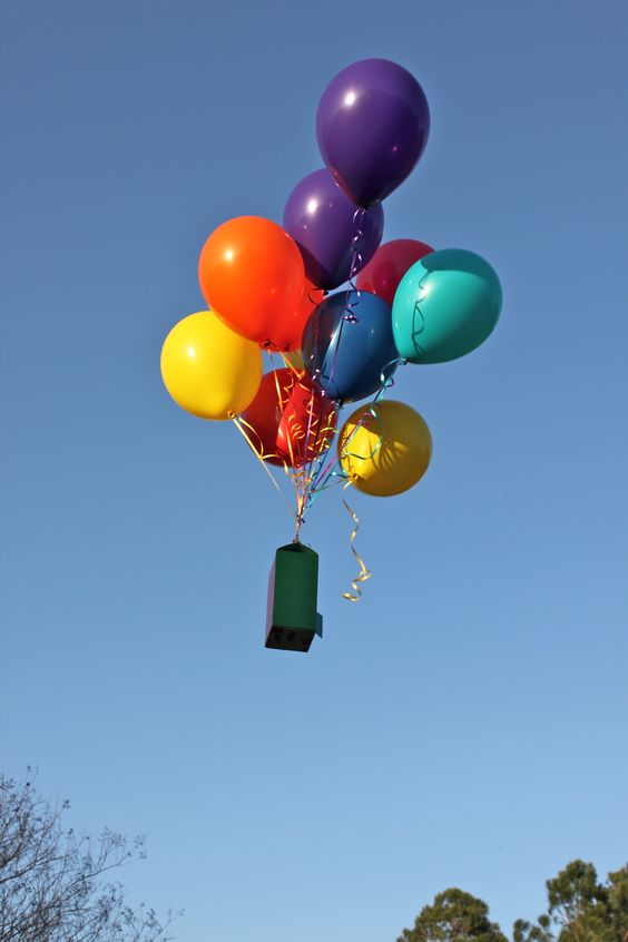 Milk carton weighted and balloons for yard
