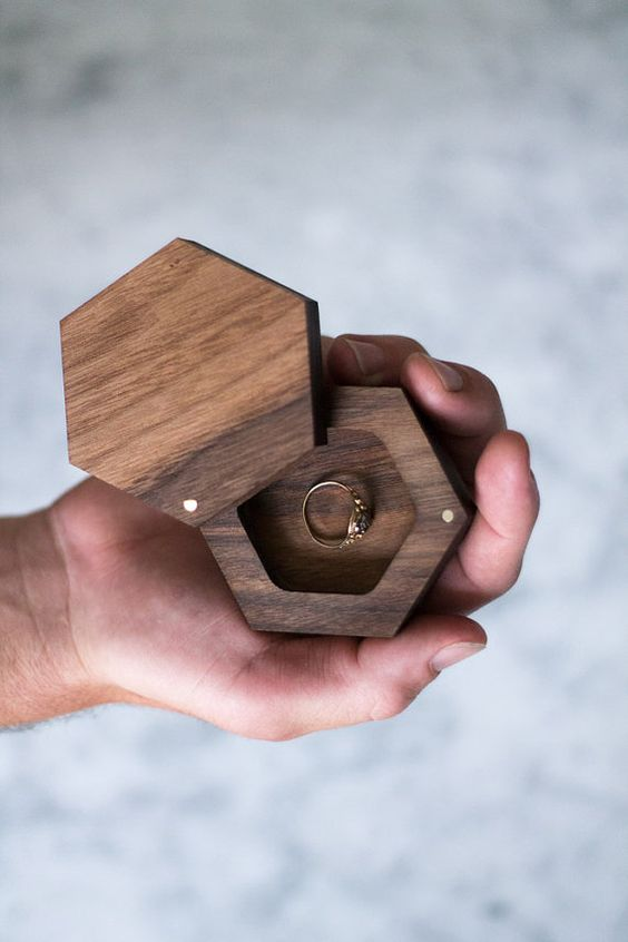 Welcome to The Duo Studio! One of our favorites! This walnut ring box is perfect for the modern or rustic lover. Comes with brass inlay swivel and