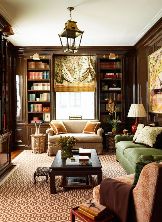 Traditional library with brown lacquered walls, green sofa, chinoiserie touches Brown and bronze