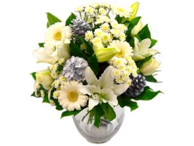Our sultry Snow White Christmas has the exciting feel of a white Christmas.  White lilies, roses and chrysanthemums are complemented by flashy silver pine cones!