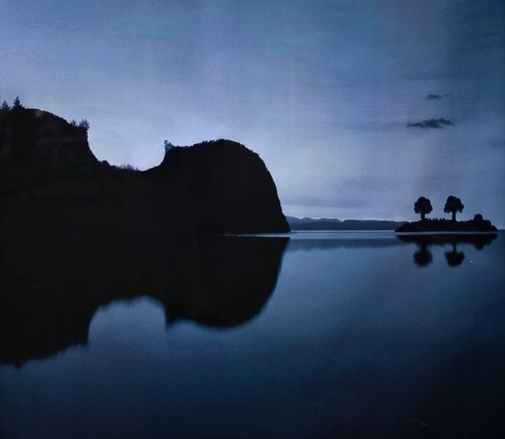This is land reflecting in water. But what else do you see???