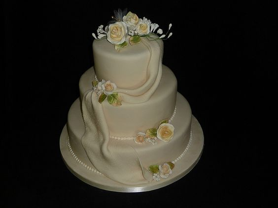"wedding cake I made for a friend's sister. There were 17x 7"" cakes for each table too. :))"