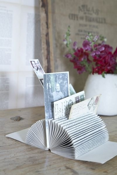 Turn a book into a picture/card holder.   I saw this on the Nate show originally.  You can also use it to hold mail, receipts, etc.  You can also go here for instructions:  http://www.curbly.com/users/diy-maven/posts/6116-turn-a-book-into-a-picture-card-holder